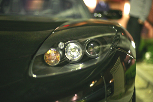 A detail shot of the front headlight assembly on the first production model Tesla, owned by Elon Musk.