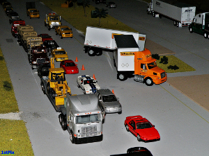 """Jack-knife Truck on the Hi-Way Diecast Diorama: Traffic is at a crawl as crews wait on a heavy duty wrecker to arrive to assist getting this """"Yellow"""" double back on its' axles and on the highway after an unfortunate mishap."""