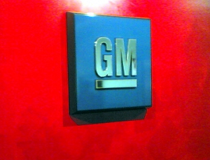 The General Motors corporate logo display on an office wall.