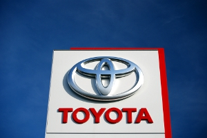 The Toyota corporate logo as seen on a dealership sign.