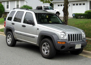 A silver 2002 Jeep Liberty SUV.