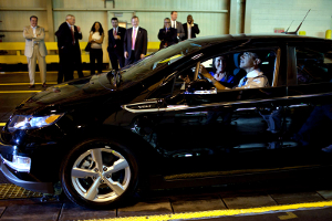 President Obama behind the wheel of a Chevy Volt, at an auto show.