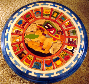 A depiction of the Mayan calendar. The Chevrolet logo has been added for comedic editorial effect.