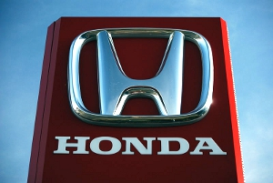 The Honda corporate logo as seen on a dealership sign.