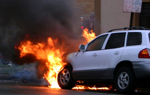 An SUV is on fire following an accident.