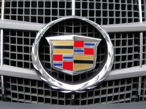 A close-up of the Cadillac logo on the front grille of a vehicle.