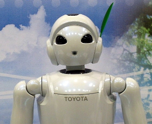A robot with the Toyota logo emblazoned across its chest.