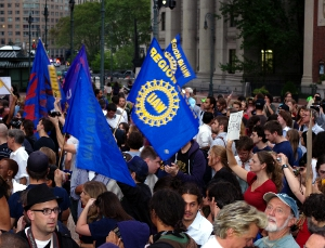 Friday, Day 14, September 30 and it has been two weeks since the protesters first descended on Wall Street. This day was a march to police headquarters as a protest against police brutality. Occupy Wall Street continues. Photos from Zuccotti Park and the march.