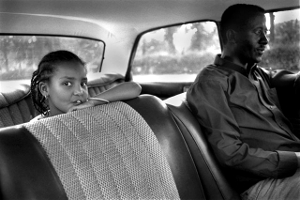 A father takes his daughter for a drive.