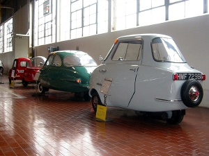 Microcars on display at a museum. The first two on the left are made by Peel.