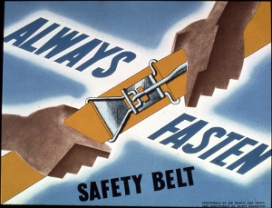 "A vintage ""fasten your seat belts"" sign from the U.S. National Archives."