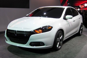A white 2013 Dodge Dart prototype on display at a 2012 auto show.
