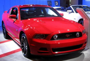 A red 2013 Ford Mustang.