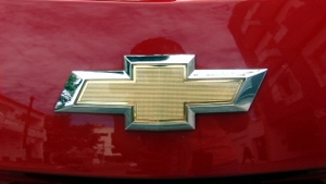 Chevrolet logo close-up, on the front of a red vehicle.