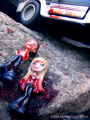 Bloodied Bratz dolls at the roadside.